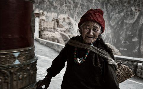 Ladakh Lady at Prayer Wheel © Hamish Scott-Brown