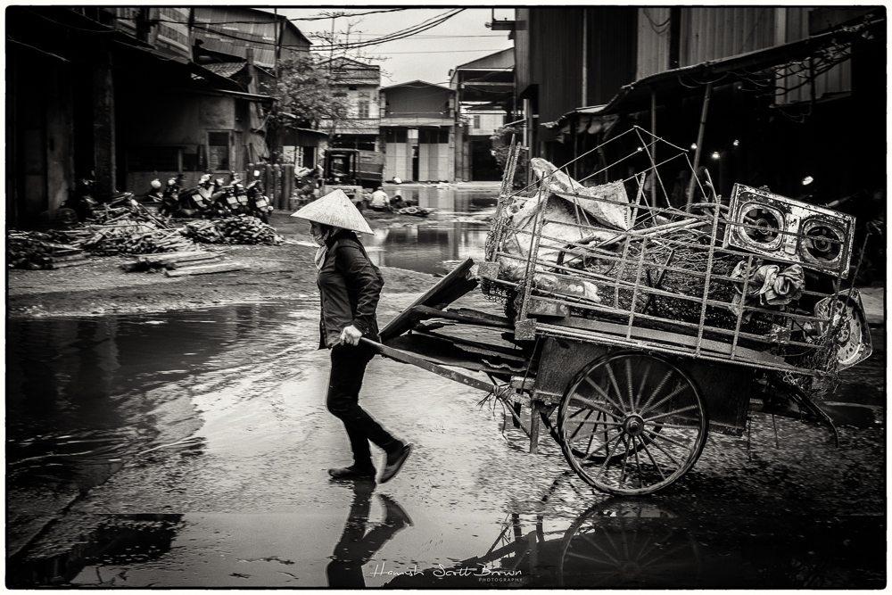 a porter at the hanoi steel works vietnam ©Hamish Scott-Brown